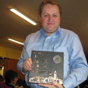 Torsten Kuhlmann mit Silberplakette